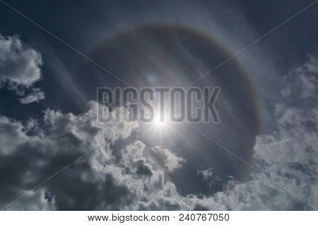 Halo Rainbow Around The Sun. Halos Are Atmospheric Phenomena Created By Light Which Is Reflected Or