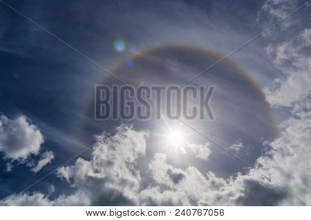 Sun Halo Phenomena. Halos Are Atmospheric Phenomena Created By Light Which Is Reflected Or Refracted