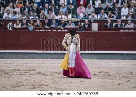 Bullfighter Man Dressed In Lights Outfit Waving.