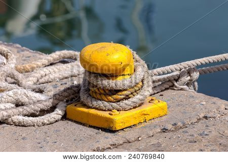 Mooring Rope On The Pier Close-up Near The Sea