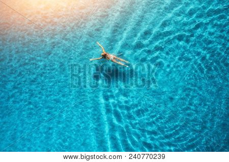 Aerial View Of Swimming Woman In Mediterranean Sea At Sunset