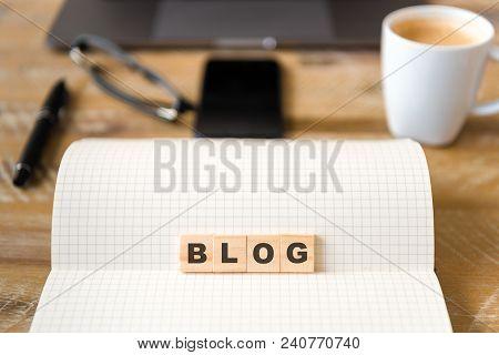 Closeup On Notebook Over Wood Table Background, Focus On Wooden Blocks With Letters Making Blog Word
