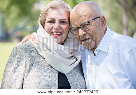 Closeup Portrait, Retired Couple In White Shirt And Dress Holding Each Other Smiling,enjoying Life T
