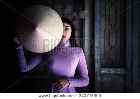 Vietnam Woman Wearing Ao Dai Culture Traditional At Old Temple At Ho Chi Minh In Vietnam,vintage Sty
