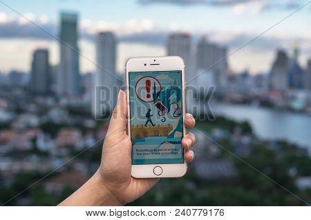 Bangkok, Thailand - Aug 7, 2016 : Hand Holding Apple Iphone5 Mobile Phone Showing The Pokemon Go App