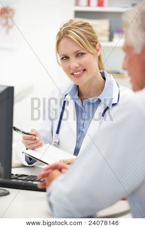Young doctor with senior patient