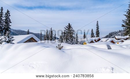 Deep Snow Pack Covering Houses And Roads Of The Alpine Village Of Sun Peaks In The Shuswap Highlands