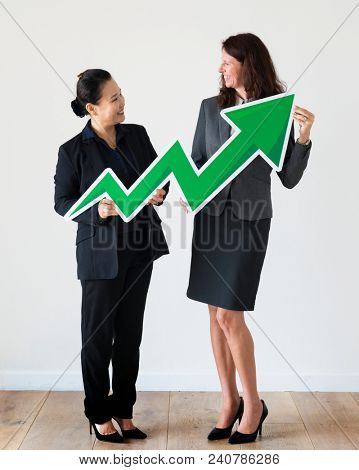 Businesswomen holding profit statistics icon