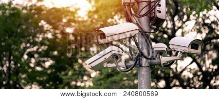 Cctv Camera Security System At The Garden Park Light In The Evening.