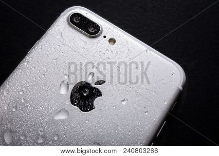Krynica, Poland, May 02, 2018:  Close Up Of The Apple Iphone 7 Plus With Water Drops On A Back Side
