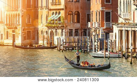 Venice, Italy - May 21, 2017: Gondolas With Tourists Sailing Along The Grand Canal In Venice. Romant