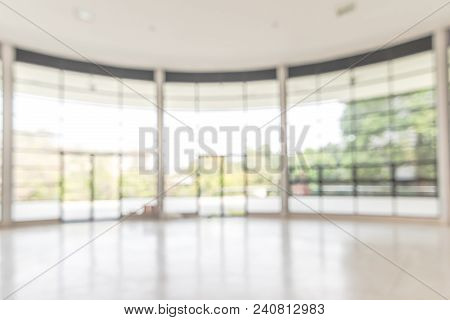 Blur Background Interior View Looking Out Toward To Empty Office Lobby And Entrance Doors And Glass