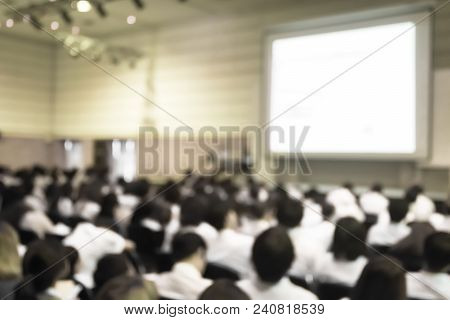 Blurred Abstract Background Of Business Or Educational Conference Seminar In Auditorium Hall