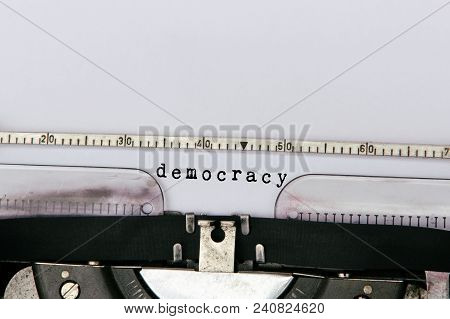 Democracy Typed On Vintage Typewriter With Copy Space