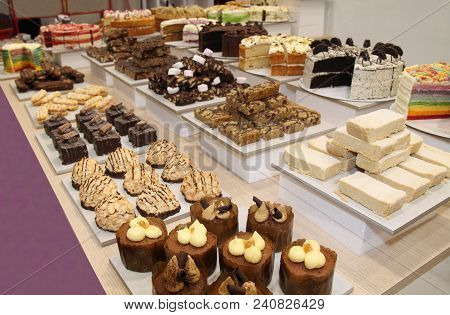 A Large Display Of Freshly Baked Cakes And Desserts.