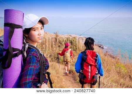 Young Asian Couple Climbing Up On The Mountain,hiking And Team Work Concept.
