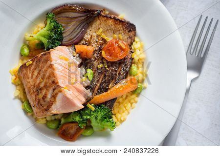Grilled Salmon Steak With Vegetables On White Plate. Healthy Food.