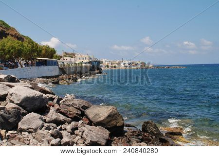 NISYROS, GREECE - JUNE 9, 2015: The rocky coastline at Mandraki on the Greek island of Nisyros. The island is best known for its still active volcano.