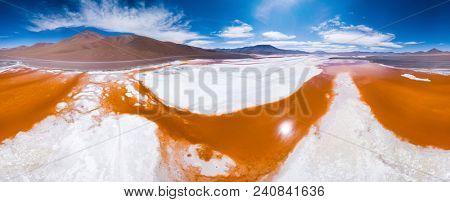 Aerial panorama of the shallow and salty Laguna Colorada in Eduardo Abaroa Andean Fauna National Reserve. Bolivia