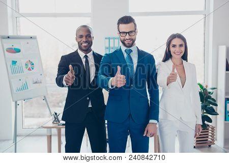 Three Stylish Modern Joyful Cheerful Businesssharks In Formalwear With Tie, Showing Thumb Up Sign, S
