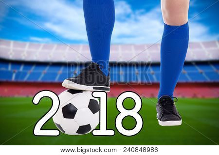 Football 2018 Concept - Soccer Player With Ball On The Stadium