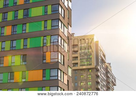 Facade Of The New Residential High-rise Buildings Against The Sky . The Concept Of Building A Typica