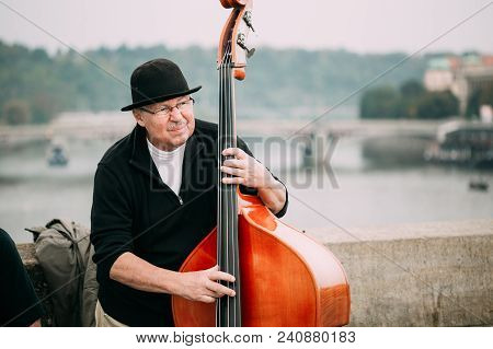 Prague, Czech Republic - October 10, 2014: Street Busker Performing Jazz Songs At The Charles Bridge
