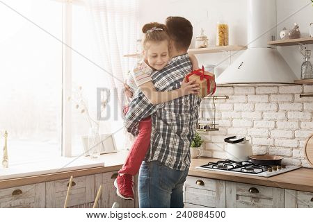 Cute Child Girl Giving Gift To Dad At Home