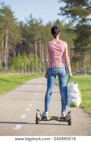 Young Woman On Hover Board. Girl Riding Hover Board In Summer Park. Balance Board For Adult.