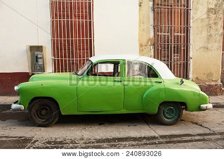 Trinidad, Cuba - December 8, 2017: Old American Car Parked On The Trinidad Street