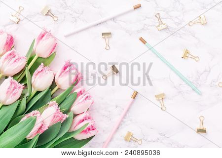 Pink Tulips With Festive Stationary On White Marble Background. Feminine Job, Gender Equality, Home