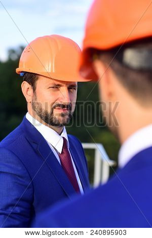 Building And Engineering Concept. Managers Wear Smart Suits, Ties And Hardhats On Nature Background,