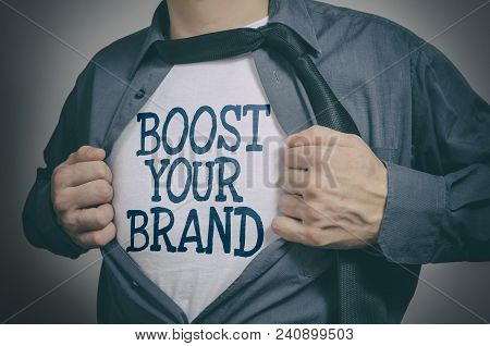 Man Showing Boost Your Brand Tittle On T-shirt