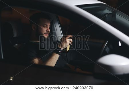 Man Drink Beer While Driving At Night In The City Dangerously, Left Hand Drive