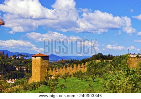 Country Dreams: An Ancient Defensive Stone Wall Running Through The Countryside Surrounding Florence
