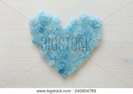 Aquamarine Is Blue. Blue Heart. Natural Stone Is Blue Aquamarine. The Background Is Aquamarine. Plac