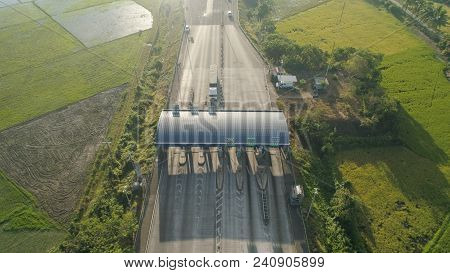 Highway With A Toll Payment Point. Aerial View: Cars Passing Through The Point Of Toll Highway, Toll