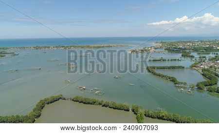 Town In Cultivated Mangroves, Ubagan, Sto Tomas. Fish Farm With Cages For Fish And Shrimp In The Phi