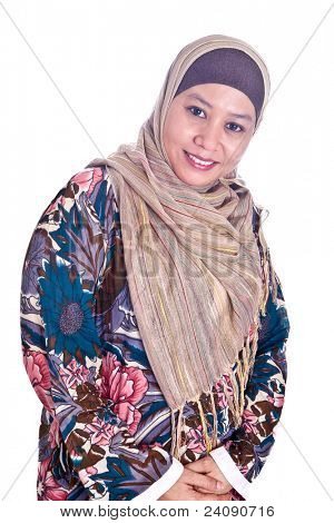 Beautiful mature Malay Muslim woman in scarf poster