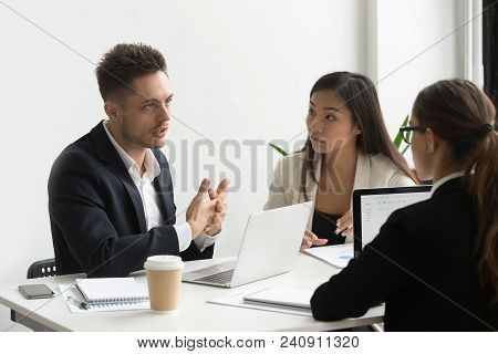 Serious Concentrated Coworkers Talking Discussing Company Business Strategies, Sharing Ideas And Tho