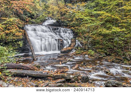 Whitewater Tumbles Down Through The Autumn Landscape Of Mohican Falls, A Waterfall In Ganoga Glen At