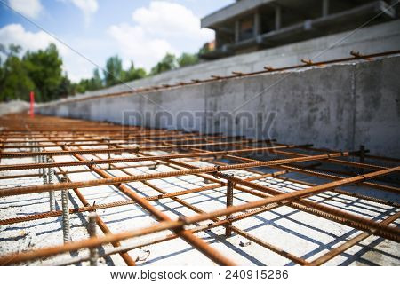 Construction Of The New Building. In The Construction Site, Steel Structure Is Under Construction. C