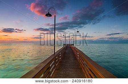 Keys Life: A Dock In The Atlantic Ocean At Sunrise, Islamorada, Florida Keys