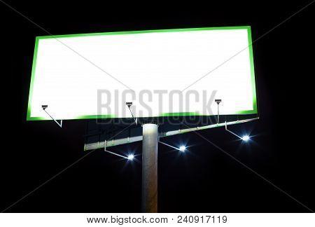 Advertising Billboard. Blank Advertising Billboard Illuminated At Night.