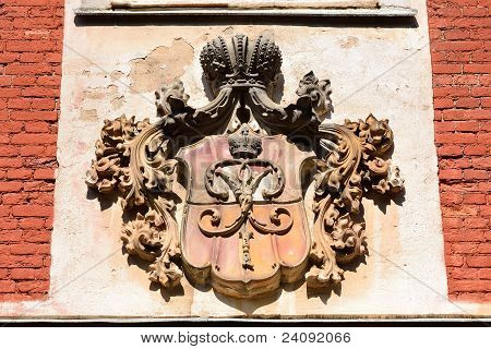 Carved stone coat of arms