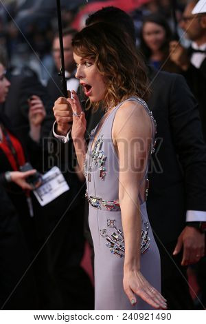 Mila Jovovich attends the screening of 'Burning' during the 71st  Cannes Film Festival at Palais des Festivals on May 16, 2018 in Cannes, France