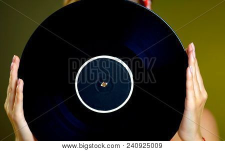 Retro woman with music vinyl record. Pin-up retro female style. Pin-up portrait of girl style wearing red dress. Classical music is better than modern music. Classical music versus modern.