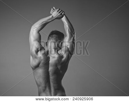 Man With Muscular Wet Body And Back. Athletic Bodybuilder Man On Grey Background. Dieting And Fitnes