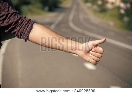 Thumbs Up Male Hand Gesture Outdoors. Hitchhiker Sign On Road. Hitchhiking, Hitching, Thumbing, Auto