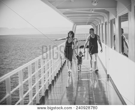 Happy Family With Cute Son On Summer Vacation. Family Travelling On Cruise Ship On Sunny Day. Family